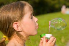 Muchacha y una burbuja de jabón Imágenes de archivo libres de regalías