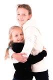 2 muchachas adolescentes en un fondo blanco Imagen de archivo