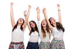 Muchachas adolescentes felices que aumentan los brazos Imagen de archivo libre de regalías