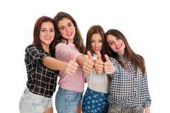 Muchachas adolescentes que hacen los pulgares para arriba Fotografía de archivo