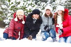 Muchachas alegres en nieve Imagenes de archivo