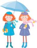 Muchachas bajo el paraguas Fotografía de archivo libre de regalías