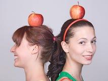 Muchachas con la manzana Fotos de archivo