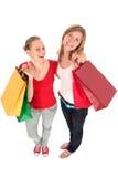 Muchachas con los bolsos de compras Imágenes de archivo libres de regalías