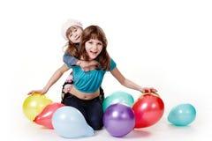Muchachas con los globos. Fotos de archivo libres de regalías