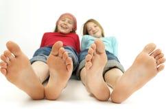 Muchachas con los ?pies grandes? Imagen de archivo libre de regalías