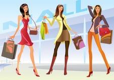 Muchachas de compras de la manera con los bolsos Foto de archivo