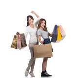 Muchachas de compras sonrientes felices Fotos de archivo