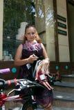 Muchachas de la acción de la bicicleta en tela escocesa en Járkov Imágenes de archivo libres de regalías