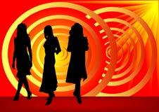 Muchachas de la manera en backgroun rojo Foto de archivo