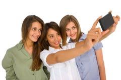 Muchachas del adolescente con smartphone Imagenes de archivo