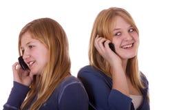Muchachas en el teléfono Fotos de archivo
