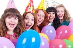 Muchachas felices con los globos abigarrados Imágenes de archivo libres de regalías