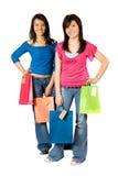 Muchachas hermosas con los bolsos de compras Imágenes de archivo libres de regalías