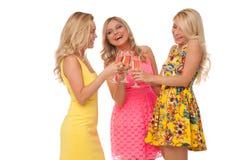 Muchachas hermosas en vestidos de la moda con champán Fotos de archivo libres de regalías