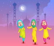 Muchachas musulmanes felices que desean a Eid Mubarak Foto de archivo