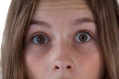 Muchachas ojo y nariz contra el fondo blanco Foto de archivo