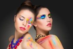 muchachas pintura de la pintura del color del maquillaje, Fotografía de archivo libre de regalías