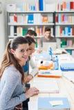 Muchachas que estudian en la sala de clase Fotografía de archivo