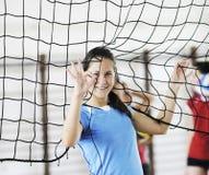 Muchachas que juegan al juego de interior del voleibol Fotografía de archivo