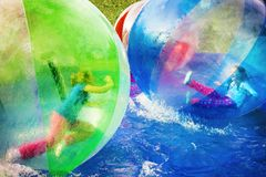 Muchachas que juegan en bolas de flotación Imágenes de archivo libres de regalías