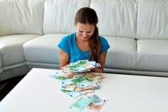 Muchachas y dinero Fotos de archivo libres de regalías