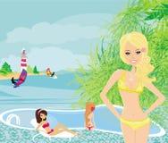 muchachas y piscina tropical Imagenes de archivo