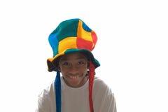 Muchacho étnico que desgasta un sombrero tonto Fotos de archivo