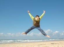 Muchacho activo en la playa Foto de archivo libre de regalías