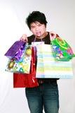 Muchacho adolescente asiático con los bolsos de compras Fotografía de archivo libre de regalías