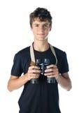 Muchacho adolescente con binocular Imagenes de archivo