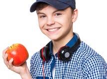 Muchacho adolescente con el casquillo y los auriculares Fotografía de archivo