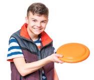 Muchacho adolescente con el disco del vuelo Foto de archivo