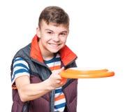 Muchacho adolescente con el disco del vuelo Fotografía de archivo