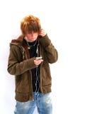 Muchacho adolescente con el jugador MP3 Imagenes de archivo