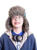 Muchacho adolescente con el sombrero del trampero Fotografía de archivo libre de regalías