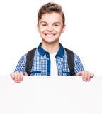 Muchacho adolescente con el tablero blanco Fotografía de archivo libre de regalías