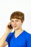 Muchacho adolescente con el teléfono elegante Fotografía de archivo libre de regalías