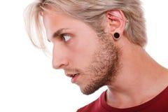 Muchacho adolescente con la perforación y el peinado de moda Imágenes de archivo libres de regalías
