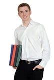Muchacho adolescente con los libros de escuela Fotos de archivo