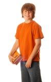 Muchacho adolescente con los libros de escuela Imagen de archivo