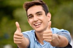 Muchacho adolescente con los pulgares para arriba Fotografía de archivo libre de regalías