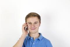 Muchacho adolescente con Smartphone Foto de archivo libre de regalías