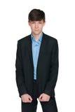 Muchacho adolescente confiado en un traje negro Fotos de archivo libres de regalías