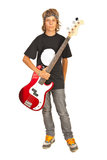 Muchacho adolescente del eje de balancín con la guitarra baja Fotos de archivo libres de regalías