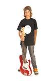 Muchacho adolescente del eje de balancín con la guitarra baja Imagenes de archivo