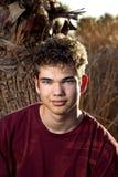Muchacho adolescente del tiro principal en marrón Fotos de archivo