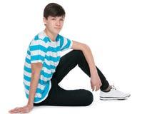 Muchacho adolescente en el piso Imagen de archivo