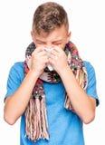 Muchacho adolescente enfermo con gripe Fotografía de archivo libre de regalías