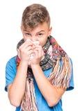 Muchacho adolescente enfermo con gripe Fotos de archivo